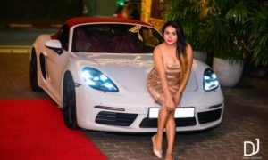 Shani Perera Posed on a Porsche