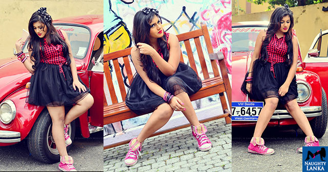 Shanudrie Priyasad Poses By A Red Volkswagen